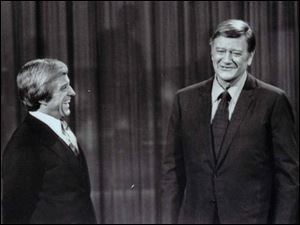 Many of Merv Griffin s interviews were filmed in black and white. Above, Griffin, left, chats with John Wayne.