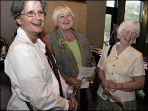 Joan Light, left, Sheri Bannister, and Jan Samples share a laugh at the W.W. Knight Nature Preserve benefit.