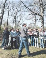 Students-mark-Arbor-Day-by-planting-trees-learning-care