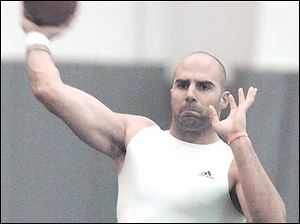 Record-setting Rockets quarterback Bruce Gradkowski works out at the UPMC Sports Complex in his hometown of Pittsburgh, preparing to take his game to the next level.