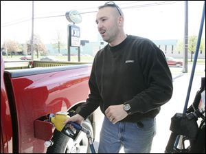 Brian Angerer fills up his pickup at the Sterling Store on Alexis Road with the fuel mix.