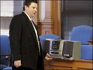 Assistant Lucas County Prosecutor Robert Miller plays a tape of a message Bob McCloskey left