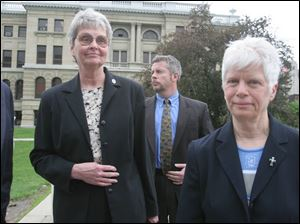 Sisters Marjorie Rudemiller, left, and Dorothy Thum leave the courthouse. Sister Marjorie thanked police and prosecutors.