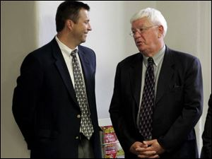 Cold-case investigators Steve Forrester, left, and Tom Ross chat