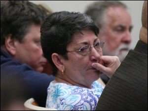 Barbara Robinson, sister-in-law of the Rev. Gerald Robinson, listens to the guilty verdict and sentence in the 1980 murder.
