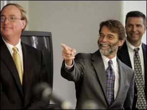 Assistant prosecutors Chris Anderson, left, and Dean Mandros enjoy some banter during a
