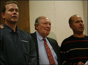 From left, Patricia Saunders' brother Michael, father Jim, and brother Jerry Staczek discuss the tragedy through their tears.
