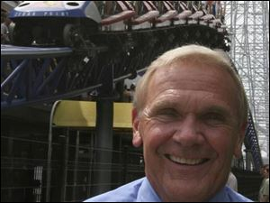 CEO Dick Kinzel said dropping some prices at Cedar Point is a response to the economy.