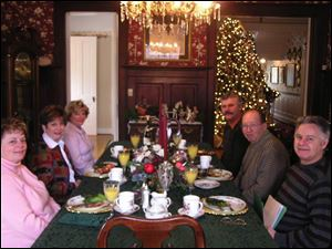 Three couples visiting from Canada settle in for breakfast at the Georgian Manor Inn.