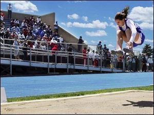 Anthony Wayne freshman Ashley Zaper leaps to a second-place finish in the long jump at 16 feet, 10 inches.