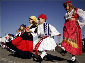 A group of children participates in an ethnic dance at last year s Greek-American Festival at Holy Trinity Orthodox Cathedral in Toledo. The festival, slated for Sept. 8-10 this year, is a celebration of the Orthodox faith and Greek culture.