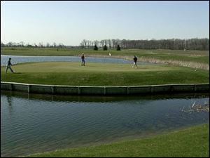 Water can become a factor on No. 8 at The Legacy in Ottawa Lake, Mich. The Island Resort there can provide golfers with lodging as they attempt to conquer the course.