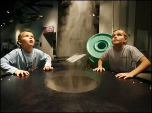 Evan and Blake Trusty of Indianapolis  check out the cloud maker at COSI Toledo.