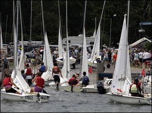 Participants in a 2005 regatta head into the Put-in-Bay Yacht Club after a week of racing.