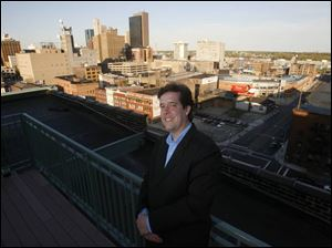 The roof of the Bartley Lofts condominiums, where Blade staff writer Christopher D. Kirkpatrick resides, features a swimming pool but also provides an impressive view of downtown Toledo s skyline.