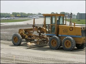 A runway at Metcalf Field in Wood County's Lake Township is graded prior to repaving.