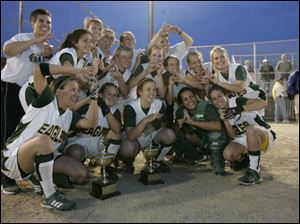The Clay softball team celebrates its first City League title yesterday at Detwiler Park.