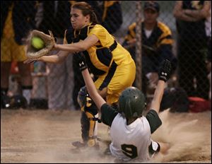 Clay s Kelsey Kelley is forced at home plate in the sixth inning by ND s Angie Bollin.