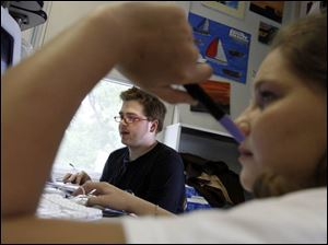 Chris Petri, with 15-year-old Marie Mowrey in the foreground, gets down to business during a study hall.