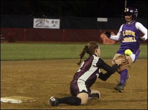 On the game's pivotal play, Genoa shortstop Kelly Traver was unable to come up with the ball on a steal of third base by Bloom-Carroll's Maria Burchett, who scored on the sequence.