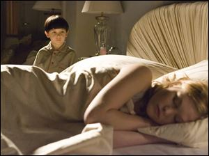 Watched by her son, Damien (Seamus Davey-Fitzpatrick), the sleeping Katherine Thorn (Julia Stiles) has no idea