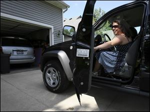Taylor Blanchard climbs into her new Jeep Liberty before driving to Whitmer High School's ceremony on June 3.