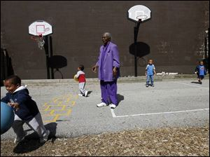 Foster grandparent Annie Bell Rayford plays with Lamar Johnson, 3.