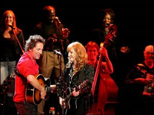 Bruce Springsteen performs with his wife, Patti Scialfa, and the Seeger Sessions Band.