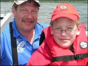 Fred Lederer and his 10-year-old son, Jacob, fish for muskies on the Clear Fork Reservoir.