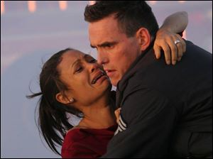 Thandie Newton and Matt Dillion in <i>Crash</i>.