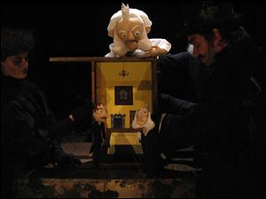 From left, Gwendolyn Warnock as Torvald, Kirjan Wagge as Little Ibsen, and David Arkema as Mini Ibsen in the company s production of The Death of Little Ibsen. The puppet show for adults, based on the life of Norwegian playwright