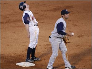 Toledo's Kevin Hooper stands on the second base bag, but it's not his to keep after he was called out attempting to steal.