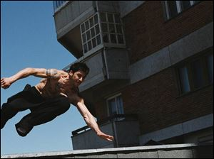 Leito (David Belle) moves among buildings in District B13.