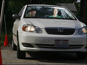 Ben Stalets, 16, of Rossford focuses intently on the task of parallel parking with driving instructor Chris Gerdeman.