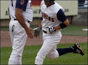 Hens manager Larry Parrish congratulates Ryan Raburn after Raburn hit a home run.