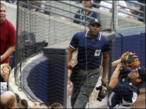 Mud Hens catcher Max St-Pierre catches a foul ball in the fourth inning last night against Indianapolis. The Indians caught up with Toledo for first place in the International League West.