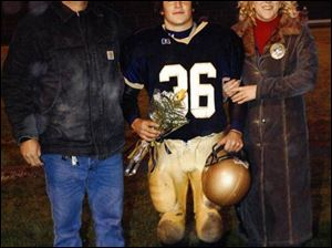 His coach had no inkling of Rusty s drug addiction. The youth is with his father, Rick Marvin, and mother, Amy Adams.