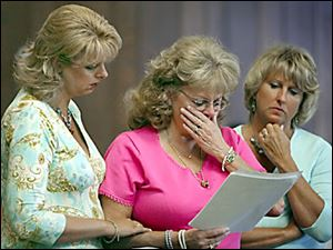 Claudia Frater, center, reads a statement to the court during the sentencing of Brian Gerwin. She is joined by her daughter Michelle Lindsay, left, and the victim's advocate Sue Jenkins.