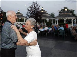 MOONLIT DANCE: As night falls upon Centennial Terrace, Leon Baumer and June Bailey's dance is sweetened by the nostalgic melodies of the Johnny Knorr Orchestra.