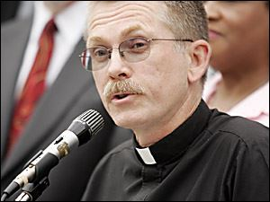 The Rev. Larry Clark calls on churches to assist a petition drive for an amendment to boost Ohio's minimum wage.