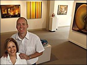 Scott and Barbara Hudson with some of the works in the exhibit in their relocated gallery.