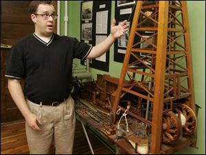 Randy Brown of the Wood County Historical Center and Museum discusses a model of a rig from the early 1900s.