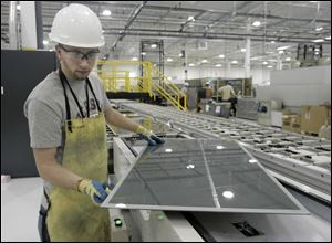 Nick Lesinszki works on a panel at a First Solar plant in Perrysburg Township. The firm is a leading developer of thin solar panels marketed for household use.