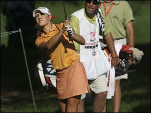 Natalie Gulbis is seeking her first LPGA Tour win, but caddie Greg Sheridan's resume includes a Farr victory in 1984.