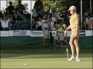 Natalie Gulbis watches as her putt on the third playoff hole refuses to fall and sends her to a second-place finish in the Farr. A run of five straight birdies on the front nine yesterday gave her a big lead, but she had nothing but pars after No. 10.