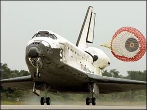 Discovery touches down this morning at Kennedy Space Center in Florida.