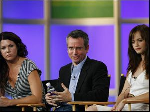 Actresses Lauren Graham, left, and Alexis Bledel listen as new producer David Rosenthal answers questions about