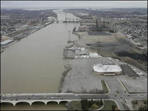 The Marina District sits on the east bank of the Maumee River. The large structure at center right is the Sports Arena.