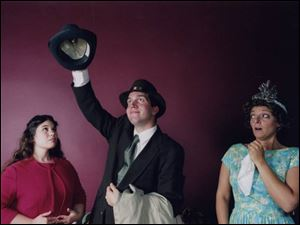 Elwood P. Dowd (Steve Copps) places a hat on his invisible friend, Harvey, as niece Myrtle, left