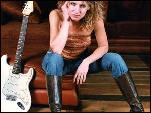 Ana Popovic will be in concert at 8 p.m. tomorrow, with Simon Carter opening, at Mickey Finn's Pub, 602 Lagrange St. Tickets are $15. Information: 419-246-3466 or 419-478-2539.